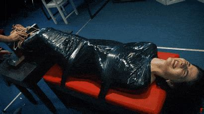 Hysterical mummification : tickling of Angela in stocks