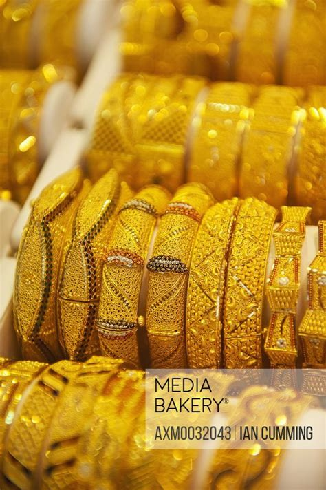 Mediabakery - Photo by Axiom Images - Gold bangles for